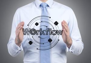 businessman holding workflow scheme in hands - Copyright 2015 Dollar Photo Club by Ivelin Radkov